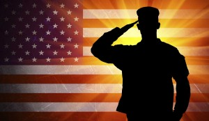 saluting male army soldier on american flag background